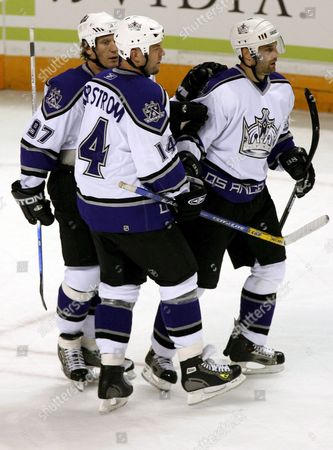 Los Angeles Kings Pavol Demitra (r) is Congratulated by Teammates Jeremy Roenick (l) and Mattias Norstrom (c) After Scoring Against San Jose Sharks Goalie Vesa Toskala During First Period Nhl Action at Hp Pavilion in San Jose California Monday 17 April 2006
