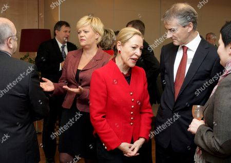 European Commissioner For External Relations Austrian Benita Ferrero Waldner (c) Chats with Norwegian Foreign Minister Jonas Gahr Store (r) with Norway's Finance Ministers Kristin Halvorsen (2ndl) in the Background Prior to a Lunch with European Commission President Portuguese Jose Manuel Barroso at the Commission Headquaters in Brussels 12 November 2008