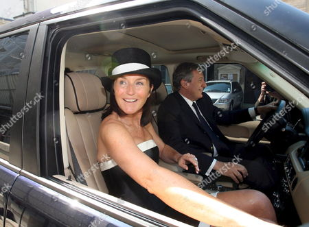 The Former Wife of French President Nicolas Sarkozy Cecilia Attias (c) Leaves the 7th Arrondissement Townhall with Her Husband Richard Attias (r) in Paris France 10 May 2008 After Attending the Marriage Ceremony of Her Daughter Jeanne-marie Martin to Gurvan Rallon