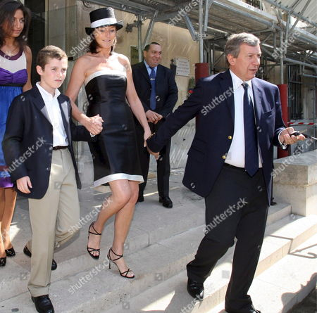 The Former Wife of French President Nicolas Sarkozy Cecilia Attias (c) Leaves the 7th Arrondissement Townhall Holding Hands with Her Son Louis Sarkozy (l) and Husband Richard Attias (r) in Paris France 10 May 2008 After Attending the Marriage Ceremony of Her Daughter Jeanne-marie Martin to Gurvan Rallon