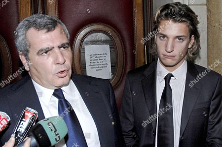 Jean Sarkozy (r) Son of French President Nicolas Sarkozy with Lawyer Thierry Hertzog (l) Questioned by Journalists After Attending Court in Paris France 04 December 2007 Jean Sarkozy Came to the Publics Attention After Allegedly Crashing His Scooter Into the Back of a Bmw Whose Occupant Pressed Charges of Reckless Driving and Fleeing the Scene of an Accident