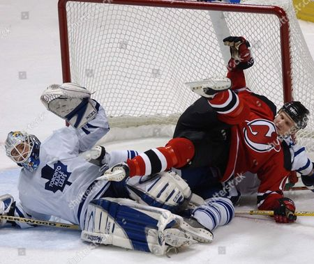 New Jersey Devil Erik Rasmussen (r) Maple Leaf Goalie Ed Balfour (l) and Maple Leaf Wade Belak (under Rasmussen) Get Tied Up in the Goal During New Jersey's Home Opener Against the Toronto Maple Leafs Thursday 16 October 2003 at Continental Arena East Rutherford New Jersey the Game Ended in a 2-2 Tie