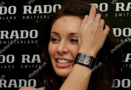 Bollywood Actress and Model Lisa Ray Poses with Newly Unveiled Watch During the Launch of New Collection of Rado Watch Company From Switzerland in Calcutta India 20 February 2008 Rado Opens Exclusive Showroom in Calcutta in West Bengal