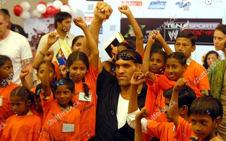 Stock Picture of The Great Khali World Wrestling Entertainment (wwe) Wrestler Poses with Children From a Door-step School an Ngo Providing Education to Underprivileged Children in Mumbai India 09 May 2008 Khali Whose Original Name is Dalip Singh Rana 7 Feet 3 Inches Tall and Weighing 190 Kilograms From Himachal Pradesh Village Joined Punjab Police Force and Went On to Us to Become a Wwe Star Wrestler Came Visiting India Last Week