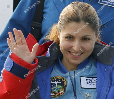 Us Entrepreneur and the World's First Female Space Tourist Anousheh Ansari Waves During Her Arrival in Moscow After the Landing of Russian Souyz Space Capsule not Far From Kazakh Town of Arkalyk in Northern Kazakhstan (some 500 Km From Kazakh Capital of Astana) Early Friday 29 September 2006 with Us Nasa Astronaut Jeffrey Williams and Russian Cosmonaut Pavel Vinogradov
