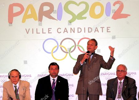 Mayor of Paris Bertrand Delanoe (2nd-r) Speaks During a Media Conference in Singapore On Monday 04 July 2005 Far Left is Alain Danet Ioc Honorary Member France's Minister For Youth Sports and Associations Jean-francois Lamour (2ndl) and Henri Serandour (r) President of the French Noc and Ioc Member London New York Madrid Moscow and Paris Are Bidding to Host the 2012 Olympic Games the Ioc Will Formally Hear the Contending Citites Bids and Announce the Winner Wednesday 06 July in Singapore