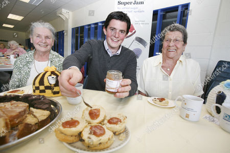 Fraser Doherty serves some of his SuperJam to Jane Tierney, 76 and Jean Ball, 84 at the launch of his new charity venture