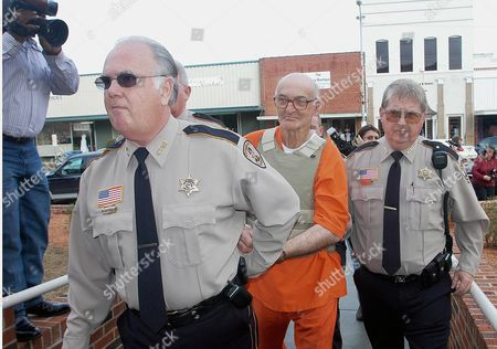 Edgar Ray Killen 79 (c) of Union Mississippi Charged with Three Counts of Murder in Connection with the June 1964 Slayings of Civil Rights Workers James Chaney Andrew Goodman and Michael Schwerner is Escorted Into the Neshoba County Courthouse in Philadelphia Mississippi For His Bond Hearing On Wednesday 12 January 2004 Judge Marcus Gordon Set Bond at $250 000 and a 28 March Court Date