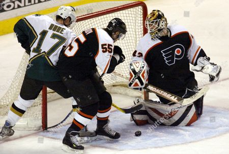Dallas Stars' Valeri Bure (l) and the Philadelphia Flyers Danny Markov (c) Battle For Control in the Crease As the Flyers Goalie Robert Esche (r) Looks For the Puck During the 3rd Period of Their Nhl Hockey Game at the Centre in Philadelphia Pennsylvania Thursday 11 March 2004 the Teams Skated to a 2-2 Tie