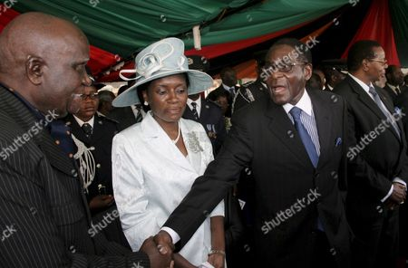 Zimbabwean President Robert Mugabe (r) Greets Zambia's Founding President Kenneth Kaunda (l) Outside the Parliament Building where They Both Attended the Inauguration of Zambia's Fourth President Rupiah Banda in Lusaka Zambia 02 November 2008 Rupiah Banda Was Hastily Sworn in As President of Zambia On 02 November After Snatching Victory From the Jaws of Opposition Leader Michael Sata Amid Accusations From the Opposition of Vote-rigging Banda 71 of the Ruling Movement For Multi-party Democracy Will Serve out the Remaining Three Years in Ex-leader Levy Mwanawasa's Term Following Mwanawasa's Death of a Stroke in August