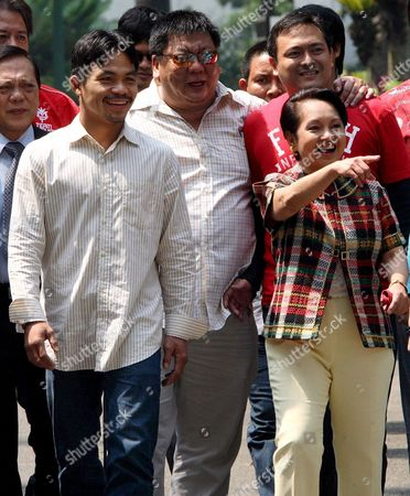 Filipino Boxing Hero Manny Pacquiao (l) Walks with Philippine President Gloria Macapagal-arroyo (r) at the Presidential Palace in Manila Philippines 11 October 2007 Pacquiao Kept His Wbc International Super Featherweight Title Via Unanimous Decision Against Mexican Boxer Marco Antonio Barrera at the Mandalay Bay Event Centre in Las Vegas Usa On 06 October 2007