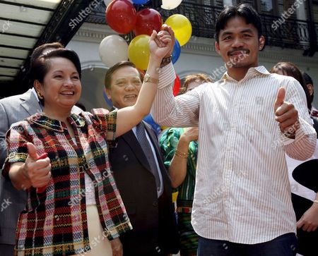 Filipino Boxing Hero Manny Pacquiao (r) Celebrates with Philippine President Gloria Macapagal-arroyo (l) at the Presidential Palace in Manila Philippines 11 October 2007 Pacquiao Was Honoured After Keeping His Wbc International Super Featherweight Title Via Unanimous Decision Against Mexican Boxer Marco Antonio Barrera at the Mandalay Bay Event Centre in Las Vegas Usa On 06 October 2007