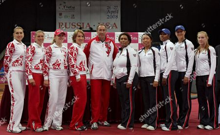 Russian Tennis Team Players Elena Vesnina (l) Vera Zvonareva (2-l) Anna Chakvetadze (3-l) Svetlana Kuznetsova (4-l) Russian Team Captain Shamil Tarpischev (5-l) and Us Team Captain Zina Garrison (5-r) Us Tennis Team Players Vania King (4-r) Ahsha Rolle (3-r) Liezel Huber (2-r) Madison Brengle (r) Pose For a Picture During the Drawing Ceremony For the Federation Cup Semifinal in Moscow Russia 25 April 2008 Federation Cup Semifinal Russia Vs Usa Will Take Place in Moscow 26-27 April