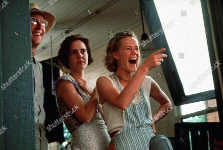 Stock Photo of 'Fried Green Tomatoes' -   Idgie Threadgoode (Mary Stuart Masterson) and Ruth Jamson (Mary-Louise Parker) have a laugh with Ed Couch (Gailard Sartain).