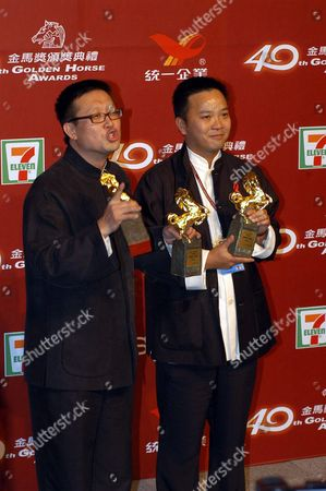 Hong Kong Directors Andrew Lau (l) and Alan Mak (r) Pose with Their Awards at the 40th Golden Horse Awards Ceremony in Tainan 13 December 2003 Lau and Mak Won the Best Director Category For Their Film 'Infernal Affairs'
