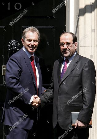 British Prime Minister Tony Blair (l) Greets the Iraqi Prime Minister Nouri Kamil Al-maliki On His Arrival Blair's London Residence 10 Downing Street Monday 24 July 2006 Ahead of a Lunchtime Meeting