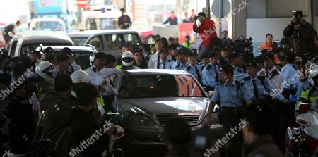 Police Officers Safeguard the Car Carrying Hong Kong Actor and Singer Edison Chen As He Leaves a Press Conference in Hong Kong China 21 February 2008 Chen Announced That He Will Stepping Away From the Hong Kong Entertainment Industry Indefinitely at the News Conference Chen the Centre of the Scandal Surrounding Sex Photos of Hong Kong Celebrities Circulated On the Internet After He Serviced His Computer Last Year the Sex Photos Shows Chen with Several of Hong Kong Actresses Including Singer Gillian Chung of Popular Female Duo Twins