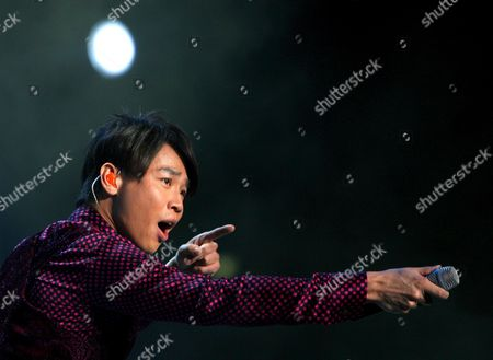 Stock Photo of Taiwanese Singer David Tao Performs During His Concert in Singapore As Part of His New World Tour 'David Tao 2008' in Singapore 19 April 2008
