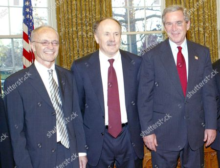United States President George W Bush (r) Greets Nobel Prize Winners Wednesday 01 December 2004 in the Oval Office at the White House in Washington (l-r) Finn Kydland From Norway and Edward Prescogtt Arizona State University