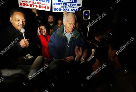 Stock Image of Reverend Jesse Jackson (l) and Actor and Activist Mike Farrell (r) Speak to the Media After a Stay of Execution From the Ninth Circuit Court of Appeals Outside San Quentin State Prison in Larkspur California Monday Evening 09 February 2004 Condemned Inmate Kevin Cooper 45 Was Convicted in 1985 of the Hacking Deaths of Christopher Hughes 11 His Friend Jessica Ryen 10 and Her Parents Douglas and Peggy Ann Ryen in Their Chino Hills California Home Cooper Was Scheduled to Die by Lethal Injection at California's San Quentin State Prison in Larkspur California Tuesday 10 February 2004 Shortly After Midnight Clemency Was Denied by California Governor Arnold Schwarzenegger
