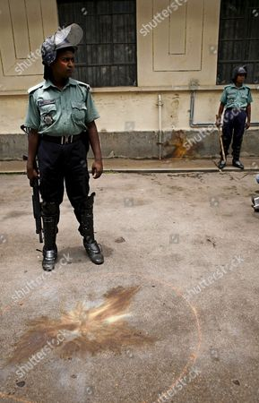 Stock Picture of Bangladeshi Policemen Stand Guard at Dhaka University Campus in Bangladesh 17 July 2007 Three Small Bombs Exploded at Dhaka University Causing Panic But No Casualties As Students Tried to Call a Strike Over the Arrest of Former Prime Minister Sheikh Hasina Wajed Police Said