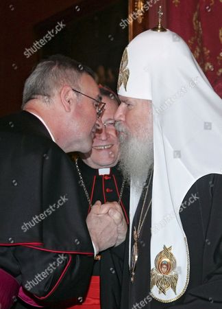 Stock Picture of Patriarch of Moscow and All Russia Alexy Ii (r) Welcomes President of the Pontifical Council For Promoting Christian Unity Walter Cardinal Kasper (c) and Archbishop Antonio Mennini Apostolic Nuncio to Russian Federation (l) in Patriarch's Residence in Moscow Russia 29 May 2008 the Meeting Was to Discuss Possible Widening of Cooperation Between Russian Orthodox Church and Vatican