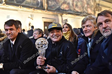 Argentinian former soccer player Diego Armando Maradona (2-L) is flanked by Italian former soccer players Paolo Maldini (L), Giancarlo Antognoni (2-R) and Marco Tardelli (R) after being inducted into the Italian soccer Hall of Fame, Florence, Italy, 17 January 2017.