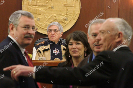 Alaska Lt. Gov. Byron Mallott, second from left, presides over the opening session of the Alaska Legislature, in Juneau, Alaska. Shown on the left is Rep. Dan Saddler, R-Eagle River, and to the right of Mallott are House Minority Leader Charisse Millett, R-Anchorage; House Speaker Bryce Edgmon, D-Dillingham, and Rep. Steve Thompson, R-Fairbanks