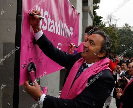 Rep. Ami Bera, D-Calif., signs a banner supporting Planned Parenthood at the Capitol Pink Out Day 2017 rally, in Sacramento, Calif. Proponents rallied against House Speaker Paul Ryan's budget bill which would halt federal funding for Planned Parenthood