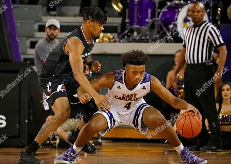 Stock Image of Jacob Evans, Elijah Hughes East Carolina's Elijah Hughes (4) tries to maintain control of the ball in front of Cincinnati's Jacob Evans (1) during the first half of an NCAA college basketball game in Greenville, N.C