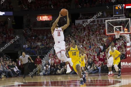 Wisconsin Badgers guard Jordan Hill #11 catches a long pass in the final seconds of the game during the NCAA Basketball game between the Wisconsin Badgers and the Michigan Wolverines at the Kohl Center in Madison, WI. Wisconsin defeated Michigan 68-64