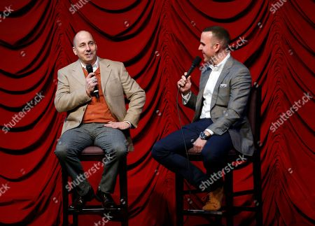 """Brian Cashman, Ryan Ruocco New York Yankees general manager Brian Cashman, left, speaks to YES network broadcaster Ryan Ruocco, in New York. Cashman compared the Yankees now to when he first went to work for New York in the 1980s, what he described as a """"second-division team,"""" By the 1990s, the farm system produced Bernie Williams, Derek Jeter, Mariano Rivera, Andy Pettitte and Jorge Posada"""