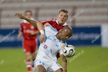 Bayern Munich Sebastian Schweinsteiger Vies with Olympique Marseille's Toifilou Maolida During a Match For Third Place at the Mohammed Bin Rashed Cup in Dubai United Arab Emirates Wednesday 10 January 2007
