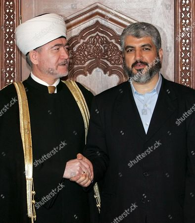 The Grand Mufty of Russian Federation Ravil Gainutdin (l) Shakes Hands with Hamas Supreme Leader Khaled Mashaal (r) During Their Meeting in Moscow Tuesday 27 February 2007