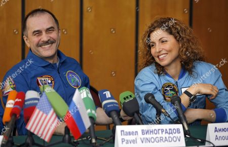 Us Entrepreneur and the World's First Female Space Tourist Anousheh Ansari (r) and Russian Cosmonaut Pavel Vinogradov (l) Smiles During a News Conference in Star City Outside Moscow Monday 02 October 2006