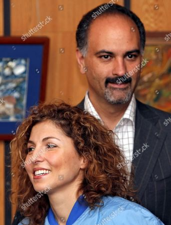 Us Entrepreneur and the World's First Female Space Tourist Anousheh Ansari and Her Husband Hamid Smiles After a News Conference in Star City Outside Moscow Monday 02 October 2006