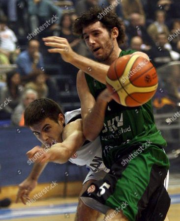 Rodolfo Fernandez of Joventut (l) Struggles For the Ball with Novica Velickovic of Partizan Belgrade During Their Euroleague Basketball Match in Belgrade On Wednesday 03 January 2006