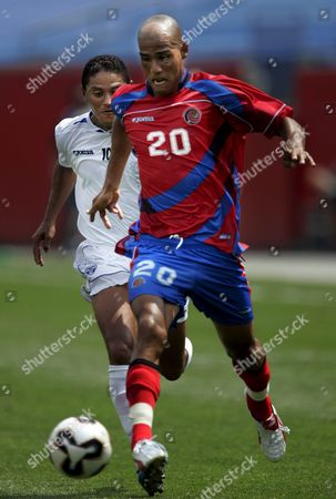 Honduras Forward Wilmer Velasquez (l) Challenges For the Ball with Costa Rica Defender Douglas Sequeira (r) During the Second Half of Their Concacaf Gold Cup Tournament Quarterfinal Soccer Match at the Gillette Stadium in Foxboro Massachusetts Saturday 16 July 2005 Hondoras Won 3-2