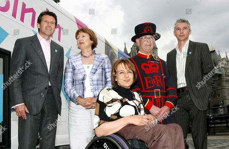 (l-r) Lord Coe Chairman of Locog Tessa Jowell Secretary of State Tanni Grey-thompson Paralympian a Beefeater and Olympian Jonathon Edwards Pose For Photographs in Front of the Official London 2012 Roadshow Bus in Central London 13 June 2007 the 2012 Roadshow Will Tour Briatin Making 27 Stops Over a Ten Week Period Encouraging Young People Across the Nation to Get Involved in Sports