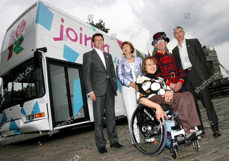 From Left to Right Lord Coe Chairman of Locog Tessa Jowell Secretary of State Tanni Grey-thompson Paralympian a Beefeater and Olympian Jonathon Edwards Pose For Photographs in Front of the Official London 2012 Roadshow Bus in Central London 13 June 2007 the 2012 Roadshow Will Tour Britain Making 27 Stops Over a Ten Week Period Encouraging Young People Across the Nation to Get Involved in Sports