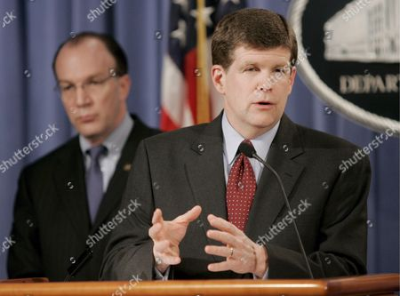 (l-r) Stuart Bowen Special Inspector General For Iraq Reconstruction Listens As Deputy Attorney General Paul Mcnulty Speaks at a News Conference at the Us Department of Justice in Washington Dc On 07 February 2007 the Officials Discussed an Indictment That Was Unsealed Today Which Alleges a Conspiracy Between Coalition Provisional Authority Officials Military Officers and Private Citizens to Steal Money Intended For Contracts to Rebuild Iraq After the American Invasion