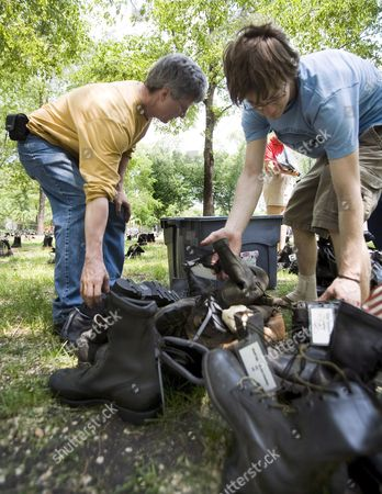 Andy Boyd (r) and Tony Heriza (l) Organize Military Style Boots Representing Fallen Soldiers From Utah That Will Be Part of a Memorial Exhibit in Chicago Illinois' Grant Park 24 May 2007 the Exhibit Titled 'Eyes Wide Open: an Exhibition On the Human Coast of the Iraq War' Contains Nearly 3 500 Pair of Boots One Pair For Each U S Soldier Killed in Iraq It is Expected That Hundreds of People Will Walk Among the Boots Each Pair Tagged with the Name of a Soldier During the Memorial Day Holiday Weekend