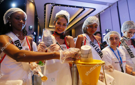 Deshauna Barber, Chalita Suansane, Jayathi De Silva, Dijana Cvijetic Miss Universe contestants, from left, Deshauna Barber of the United States, Chalita Suansane of Thailand, Jayathi De Silva of Sri Lanka and Dijana Cvijetic of Switzerland, help pack meals for distribution to the needy in suburban Pasay city southeast of Manila, Philippines . Eighty-six candidates from around the world are vying for the title to succeed Pia Wurtzbach from the Philippines. The competition takes place on Jan. 30