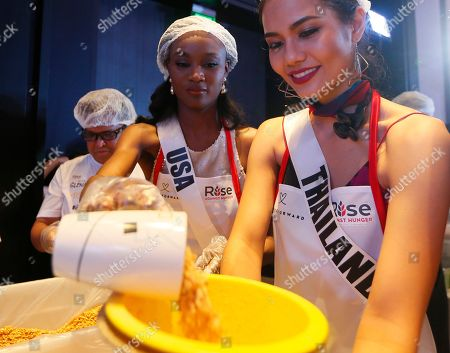 Deshauna Barber, Chalita Suansane Miss Universe contestants Deshauna Barber of the United States and Chalita Suansane of Thailand help pack meals for distribution to the needy in suburban Pasay city southeast of Manila, Philippines . Eighty-six candidates from around the world are vying for the title to succeed Pia Wurtzbach from the Philippines. The competition takes place on Jan. 30