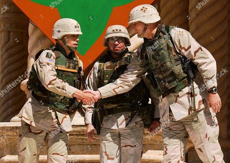 Major General John R S Batiste Commander of the 1st Infantry Division (id) (l) Shakes Hands with Major General Raymond T Odierno Commander of the 4th Id (r) As Lieutenant General Ricardo Sanchez Commander of Coalition Ground Forces in Iraq (c) Looks On During a Transfer of Authority Ceremony in Tikrit Iraq On Tuesday 16 March 2003 the 1st Id Officially Took Control of the 4th Id's Area of Operations Today Which Encompasses Most of the Sunni Triangle