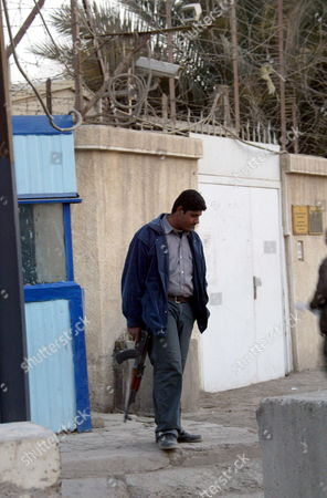 An Iraqi Policeman Stands Guard in Front of the Gate of the Turkish Embassy in Baghdad On Monday 02 January 2006 Iraqi Police Said Monday Gunmen Have Attacked the Convoy of the Turkish Ambassador to Iraq Unal Cevikoz Injuring Him Slightly