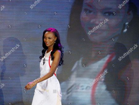 """Miss Universe candidate Deshauna Barber of the United States is introduced to the audience prior to joining the packing of meals for distribution to the needy in suburban Pasay city southeast of Manila, Philippines. Ms. Barber told reporters she did not vote for Donald Trump but adds she's hoping he can unify Americans at a """"nerve-wracking"""" point in U.S. history"""