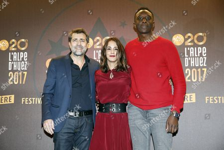 French director Ludovic Bernard (L), French actors Alice Belaidi (C) and Ahmed Sylla (R) pose during the photocall for 'l'Ascension' at the 20th annual International Comedy Film Festival, in l'Alpe d'Huez, France, 18 January 2017. The festival runs from 17 to 22 January.