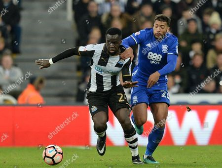 Cheik Tiote of Newcastle United (left) fends off David Davis of Birmingham City during the Emirates FA Cup Third Round match replay between Newcastle United and Birmingham City played at St. James? Park, Newcastle upon Tyne on 18th January 2017