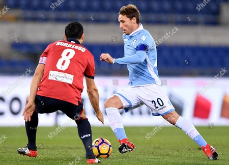 SS Lazio's Lucas Biglia (R) vies for the ball with Genoa's Nicolas Burdisso during the Italian Cup Round of 16 soccer match between SS Lazio and Genoa at the Olimpico stadium in Rome, Italy, 18 January 2017.